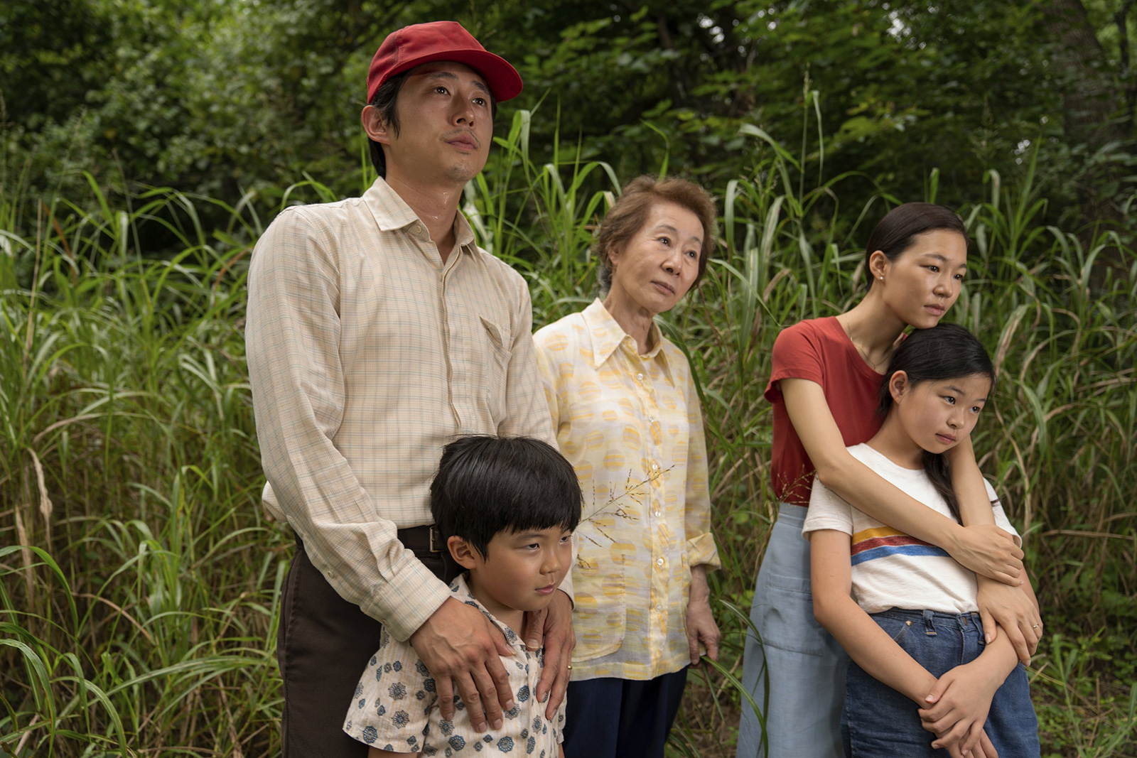 """Actors Steven Yeun, from left, Alan S. Kim, Yuh-Jung Youn, Yeri Han, and Noel Cho in a still image from the film """"Minari."""" Photo courtesy of A24"""