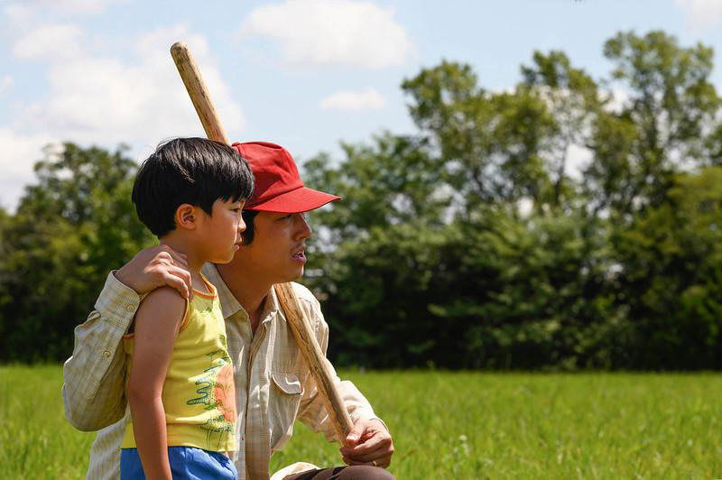 """Actors Alan S. Kim, left, and Steven Yeun, in a still image from the film """"Minari."""" Photo courtesy of A24"""