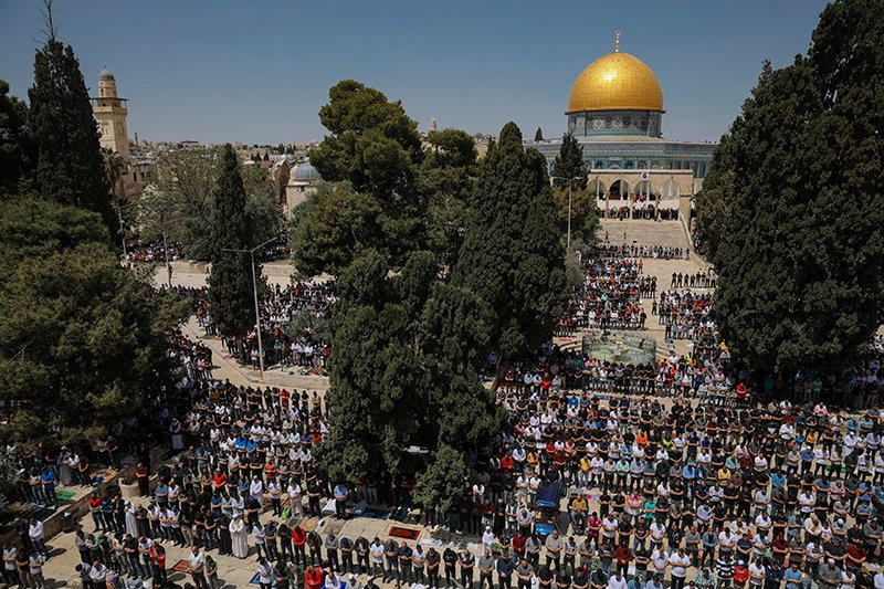 Palestinian worshipers pray during the first Friday of the holy month of Ramadan at the Al Aqsa Mosque compound in Jerusalem's old city, Friday, April 16, 2021. (AP Photo/Mahmoud Illean)