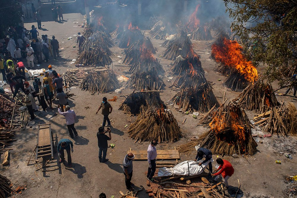 Multiple funeral pyres of COVID-19 victims burn in an area that has been converted for mass cremation in New Delhi, India, Saturday, April 24, 2021. Authorities are scrambling to get medical oxygen to hospitals where COVID-19 patients are suffocating from low supplies. The effort Saturday comes as the country with the world's worst coronavirus surge set a new global daily record of infections for the third straight day. The 346,786 infections over the past day brought India's total cases past 16 million. (AP Photo/Altaf Qadri)