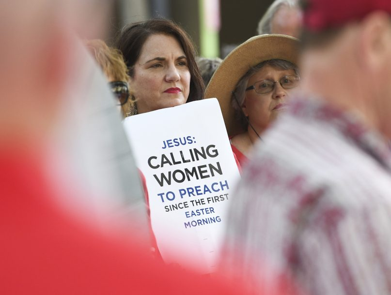 In this June 11, 2019, file photo, Janene Cates Putman of Athens, Tennessee, holds a sign during a demonstration outside the Southern Baptist Convention's annual meeting in Birmingham, Alabama. Among the millions of women belonging to churches of the Southern Baptist Convention, there are many who have questioned the faith's gender-role doctrine and more recently urged a stronger response to disclosures of sexual abuse perpetrated by SBC clergy. (AP Photo/Julie Bennett)