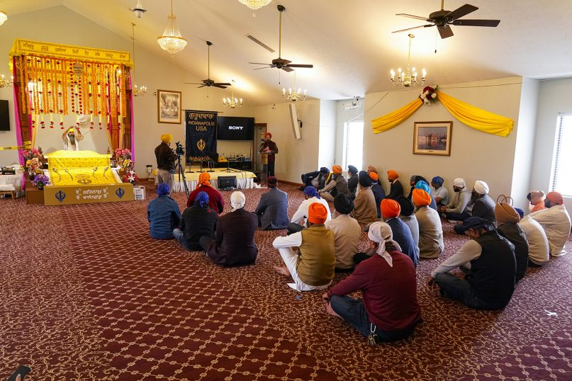 Members of the Sikh Coalition gather at the Sikh Satsang of Indianapolis on April 17, 2021, to formulate the group's response to the shooting at a FedEx facility in Indianapolis that claimed the lives of four members of the Sikh community. A gunman killed eight people and wounded several others before taking his own life in the late-night attack at a FedEx facility near the Indianapolis airport. (AP Photo/Michael Conroy)