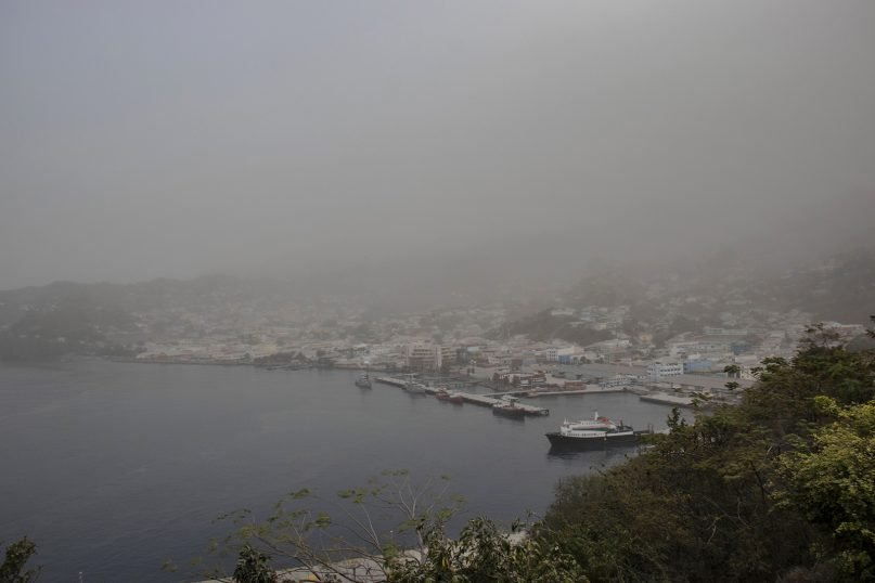 A cloud of volcanic ash hovers over Kingstown, on the eastern Caribbean island of St. Vincent, on April 10, 2021, a day after the La Soufriere volcano erupted. (AP Photo/Lucanus Ollivierre)
