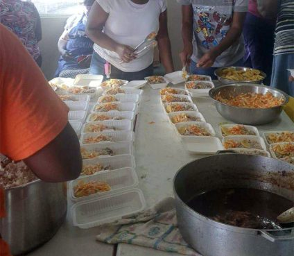 Kingstown Baptist Church members prepare emergency meals in Kingstown, St. Vincent, for those impacted by the eruption of the La Soufriere volcano on the Caribbean island. Photo courtesy of the Rev. Cecil Richards