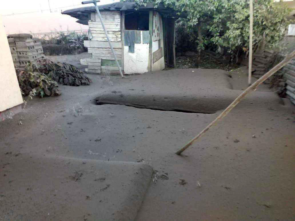 A building and yard covered in ash after the eruption of the La Soufriere volcano on the Caribbean island of St. Vincent. Photo courtesy of the Rev. Cecil Richards