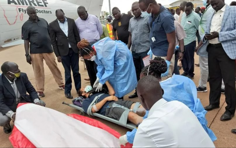 Medical professionals prepare the Rev. Christian Carlassare, on stretcher, to be airlifted to Kenya's capital, Nairobi, through the services of the African Medical and Research Foundation for specialized treatment after the priest was shot April 26, 2021, in South Sudan. Photo courtesy of ACI Africa