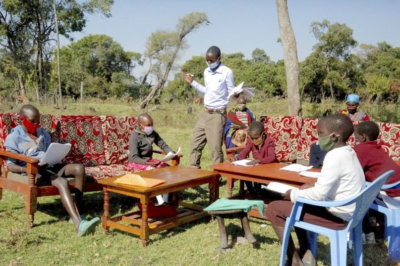 Children learning from their home with the assistance of a trained teacher (called Ezekiel) in Kirindon, Narok County, Kenya. Photo courtesy of World Vision