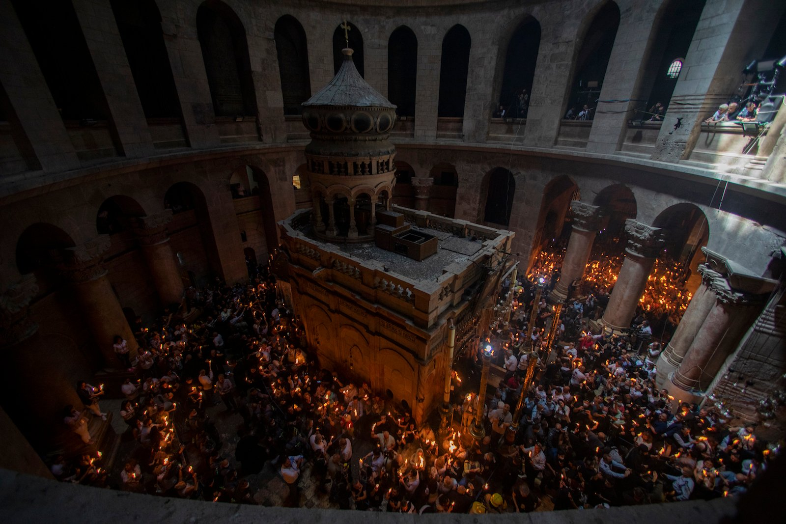 Vaccinated faithful throng Jerusalem church for Holy Fire