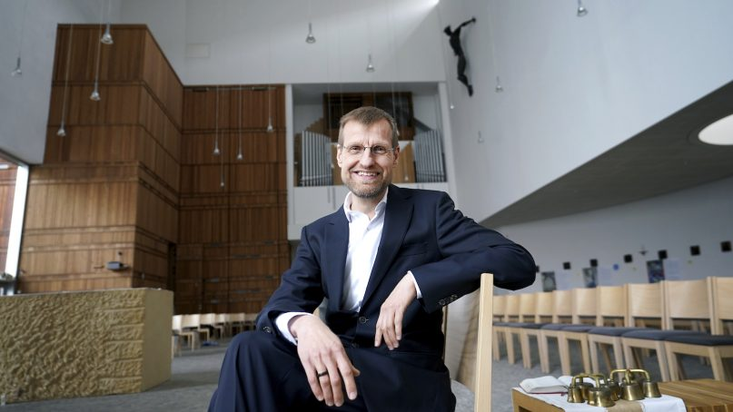 Jesuit Father Jan Korditschke, who will lead blessings for same-sex couples in Berlin in the upcoming week, poses for a photo at the Canisius Church in Berlin, Germany, Friday, May 7, 2021. Germany's Catholic progressives are openly defying a recent Holy See pronouncement that priests cannot bless same-sex unions by offering exactly such blessings at services in about 100 different churches all over the country. The blessings at open worship services are the latest pushback from German Catholics against a document released in March by the Vatican's orthodoxy office, which said Catholic clergy cannot bless same-sex unions. (AP Photo/Michael Sohn)