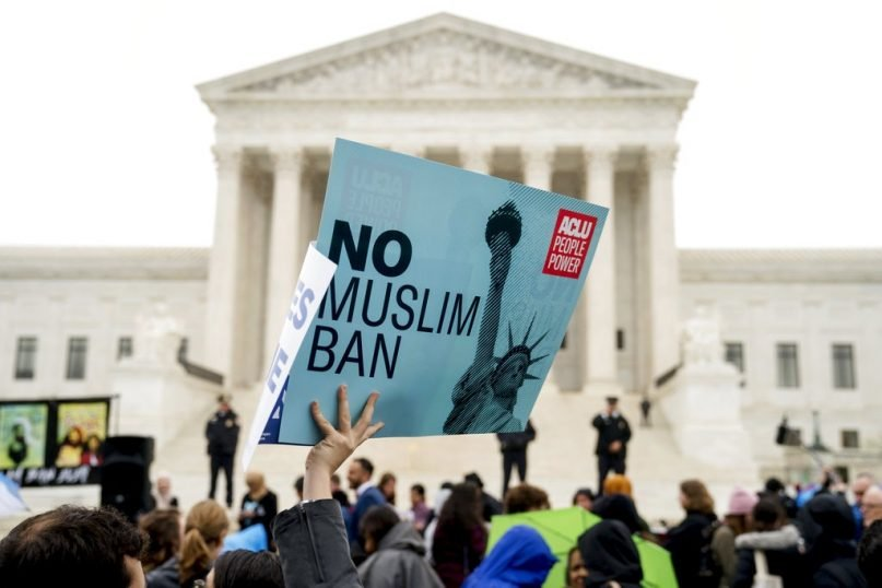 President Trump's ban on immigration from several mostly Muslim countries was ultimately upheld by the Supreme Court. President Biden revoked it on his first day in office. (Andrew Harnik/AP Photo)