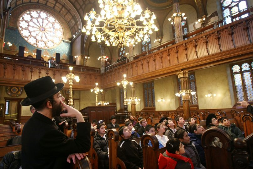 A recent Pew survey found that American Jews are increasingly becoming more diverse and politically polarized. (Mario Tama/Getty Images)