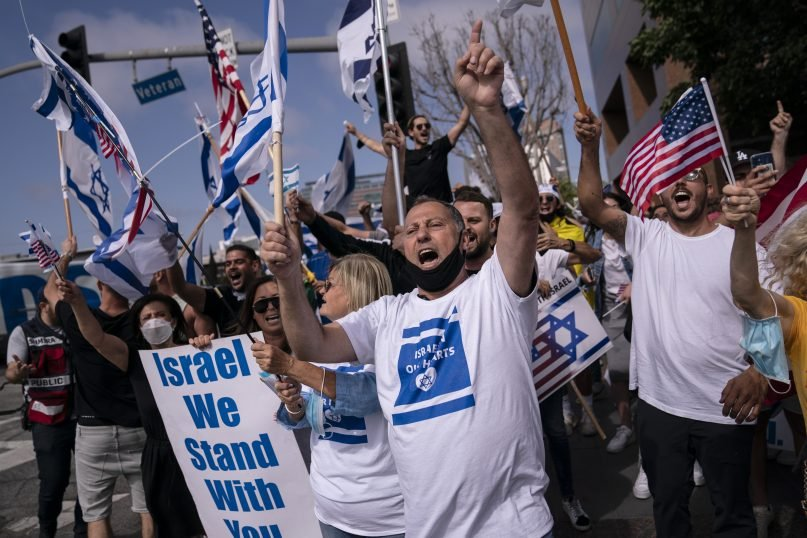 Pro-Israel supporters chant slogans during a rally in support of Israel outside the Federal Building in Los Angeles, May 12, 2021. A larger debate is playing out nationwide among many U.S. Jews who are divided over how to respond to the violence and over the disputed boundaries for acceptable criticism of Israeli policies. (AP Photo/Jae C. Hong, file)