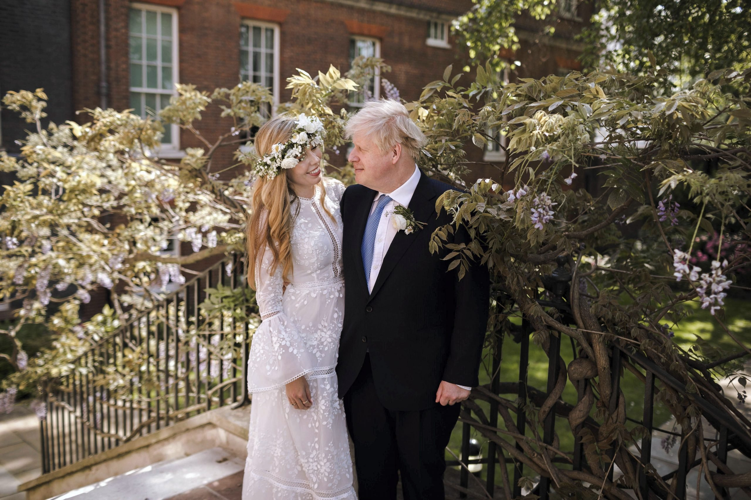 CORRECTING SOURCE TO REBECCA FULTON - In this image released Sunday May 30, 2021, by Rebecca Fulton, Britain's Prime Minister Boris Johnson and Carrie Johnson pose together for a photo in the garden of 10 Downing Street after their wedding on Saturday. Boris Johnson and his fiancée Carrie Symonds are newlyweds, according to an announcement saying they were married Saturday during a small private ceremony in London. (Rebecca Fulton via AP)