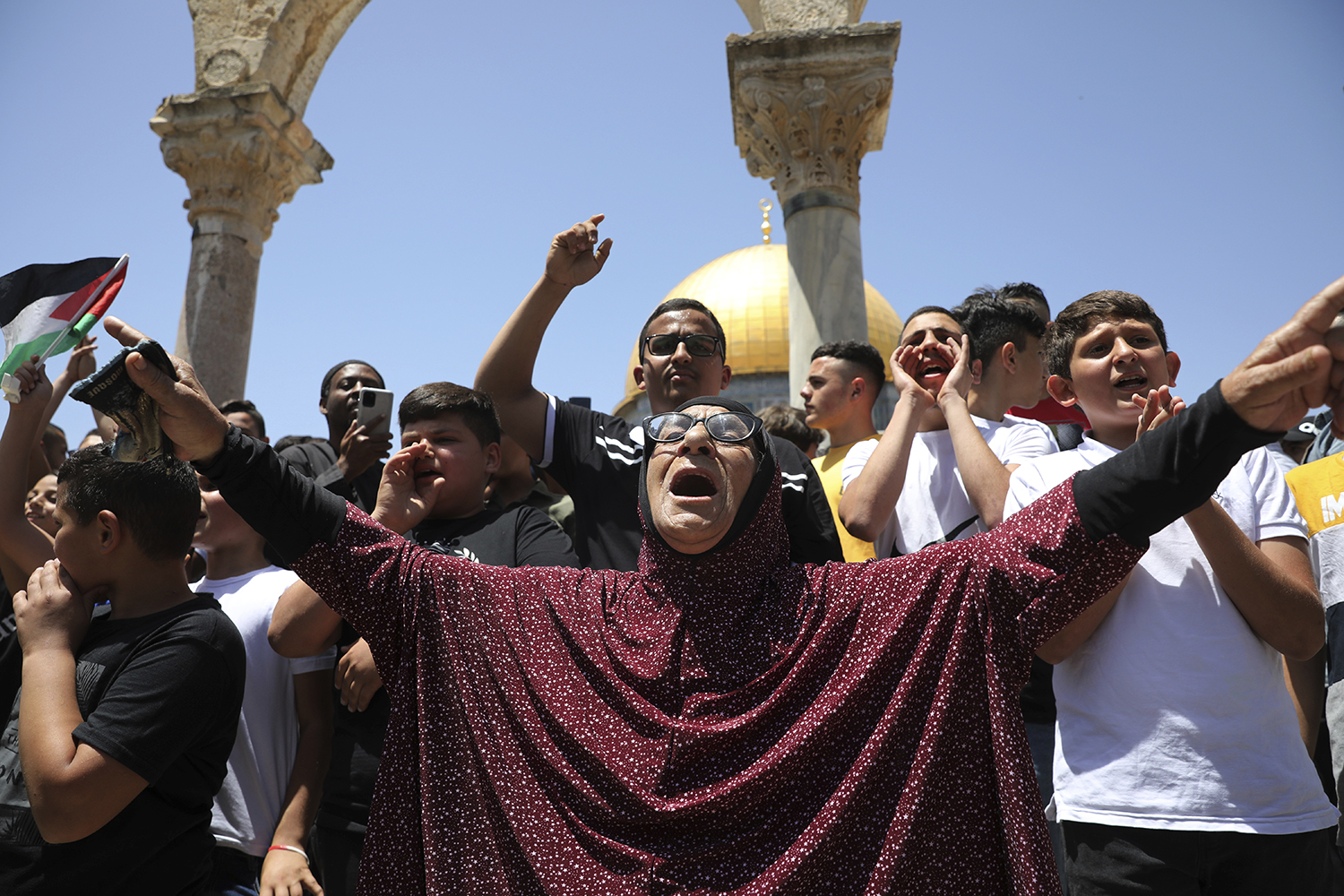 Palestinians chant slogans at a protest following Friday prayers at the Dome of the Rock Mosque at the Al-Aqsa Mosque compound in the Old City of Jerusalem, Friday, May 28, 2021. (AP Photo/Mahmoud Illean)