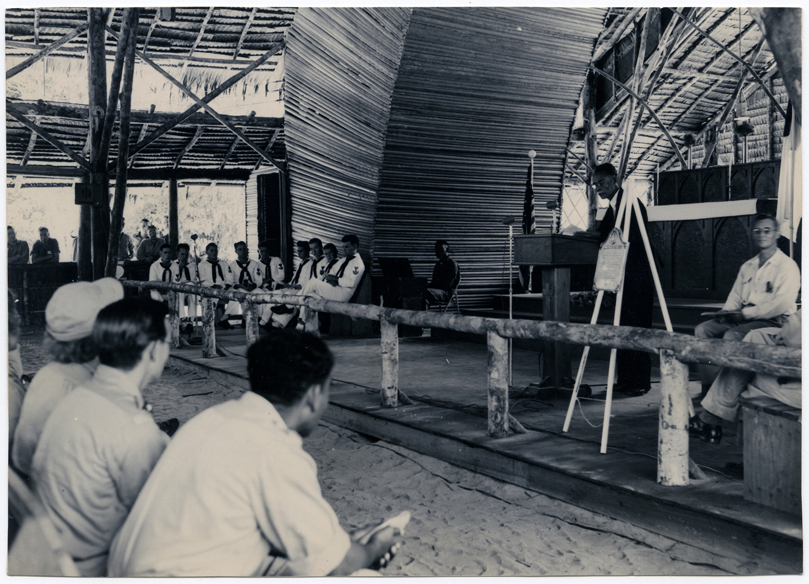 American sailors, far left, attend a service in a typical Protestant Bamboo Church in Port Moresby, the capital and largest city of Papua New Guinea, circa 1948. RNS archive photo. Photo courtesy of the Presbyterian Historical Society.