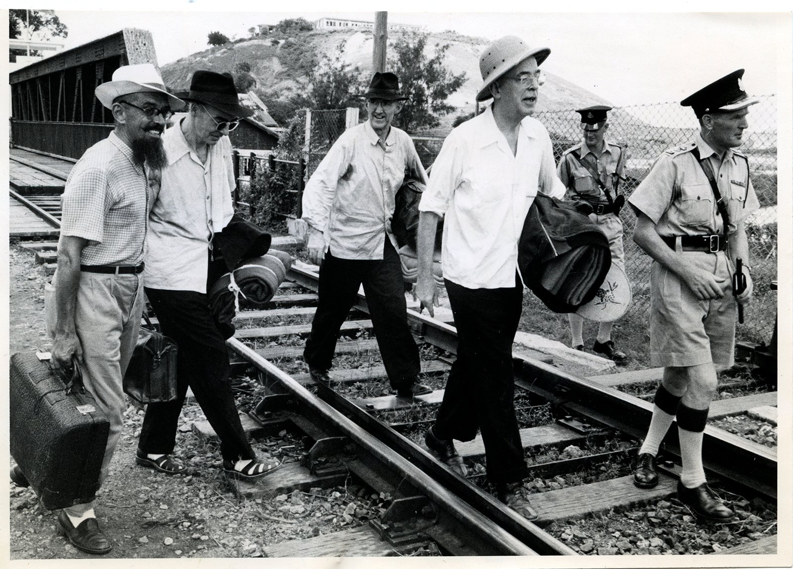 Three American Dominican priests cross Freedom Bridge to Hong Kong from Red China, where they were kept under house arrest in Foochow, Fukien Province, circa 1955. Italian priest father Ambrose Poletti, from left, greeted and escorted fathers Joseph E. Hyde of Lowell, Mass., James G. Joyce of Clinton, Mass., and Frederick A. Gordon. The three were among the first group of American clergymen freed by the communists under the Geneva Agreements. With them on far right is Police Superintendent A. L. Gordon, who was in charge of the British side of border. The trio was pale and had lost weight, but they were in good spirits. RNS archive photo. Photo courtesy of the Presbyterian Historical Society.