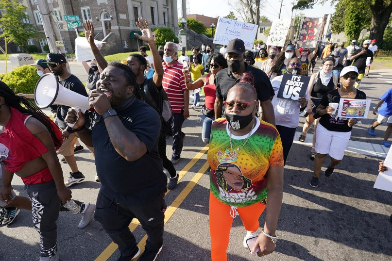 Protesters march along the streets of Elizabeth City, North Carolina, on Wednesday, April 28, 2021, to protest the shooting of Andrew Brown Jr. A judge has denied the request to immediately release body cam video of the incident. (AP Photo/Steve Helber)