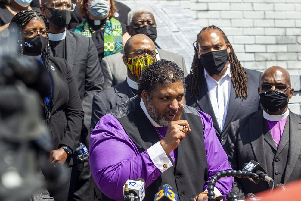 The Rev. William Barber II speaks as the North Carolina NAACP and clergy urge state attorney general Josh Stein to take over the investigation into the police shooting death of Andrew Brown Jr., during a press conference at the Mt. Lebanon AME Zion Church, Tuesday, April 27, 2021, in Elizabeth City, N.C. (Travis Long/The News & Observer via AP)