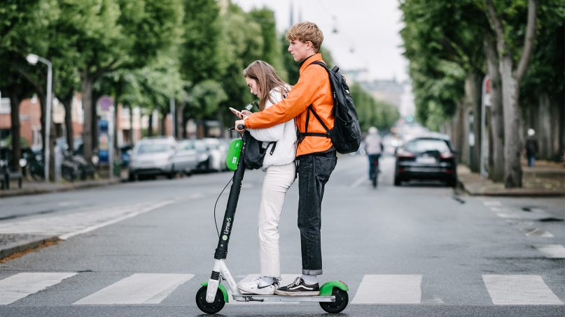 Generation Z is often stereotyped as young people using devices and electric scooters, sometimes simultaneously. Photo by Kristoffer Trolle/Creative Commons