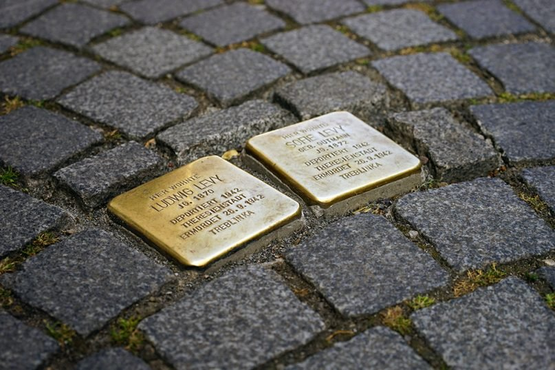 Stolpersteine (stumbling stones) memorials mark where Jews were taken from their homes or places of business during the Holocaust. Photo by Hans Braxmeier/Pixabay/Creative Commons