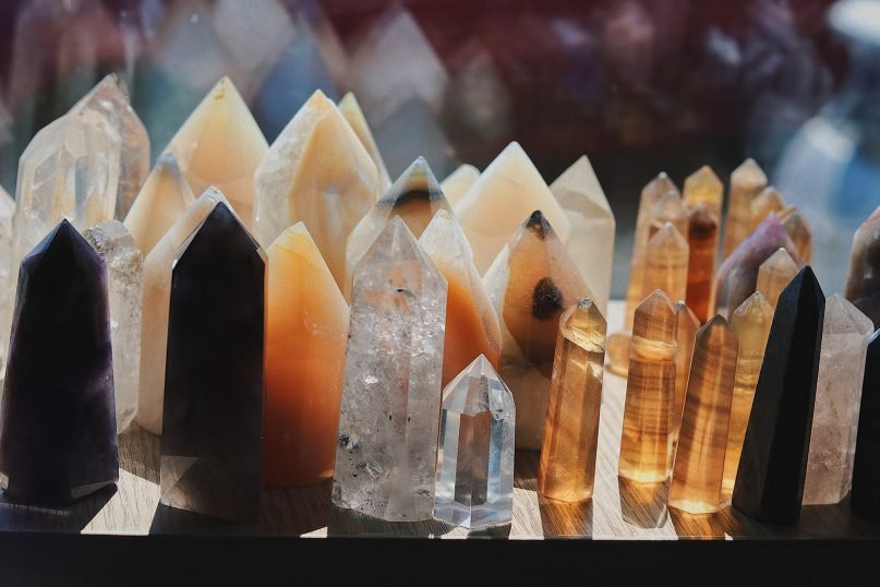 Healing crystals on display in a shop. Photo by Hasan Can Devsir/Unsplash/Creative Commons