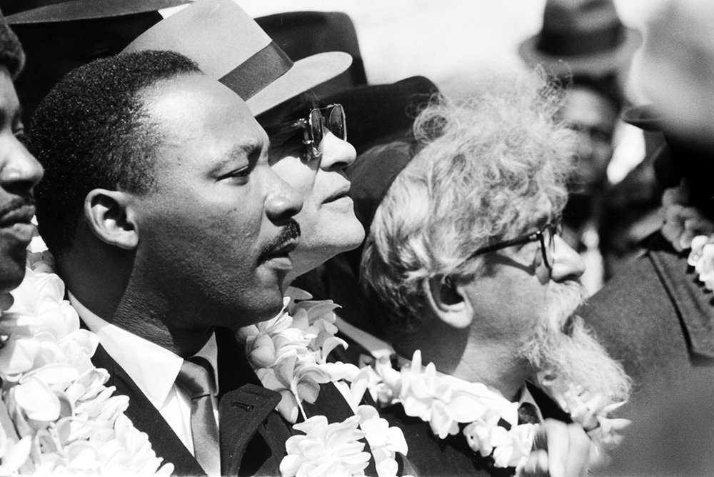 Martin Luther King Jr., left, with RabbiAbraham Joshua Heschel, right, and other leaders during the Selma March in 1965. Photo © James Karales