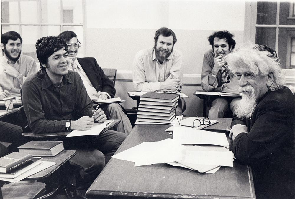 Abraham Joshua Heschel, right, teaches a class at Jewish Theological Seminary. Photo © Jewish Theological Seminary