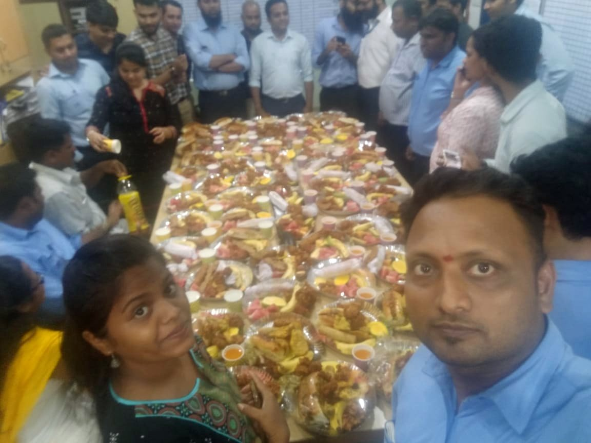 Shivaji Khairnar, bottom right, takes a photo of an iftar at his workplace in 2018. Courtesy photo