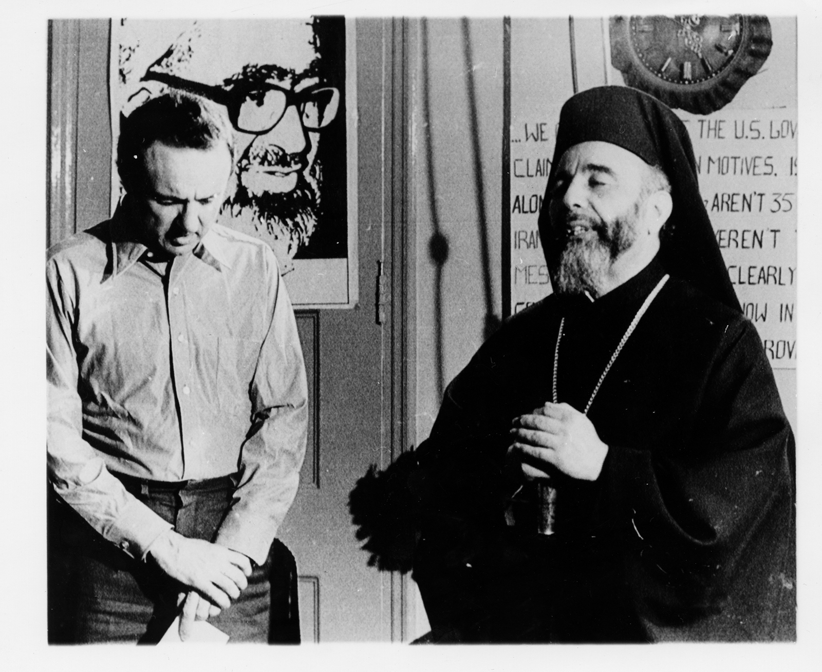 Archbishop Hilarion Capucci, of the Greek Melkite Catholic Church, prays with an unidentified hostage during an Easter visit in the U.S. Embassy in Tehran, Iran, on April 6, 1980. RNS archive photo. Photo courtesy of the Presbyterian Historical Society.