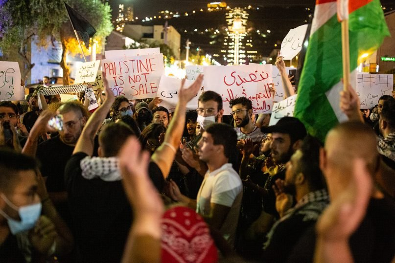 Palestinian citizens of Israel were met with a strong Israeli police response during a protest in Haifa against Israeli actions in Jerusalem's Sheikh Jarrah neighborhood and around the Al-Aqsa mosque compound, on Sunday, May 9, 2021. (Photo by Mati Milstein/NurPhoto via Getty Images)