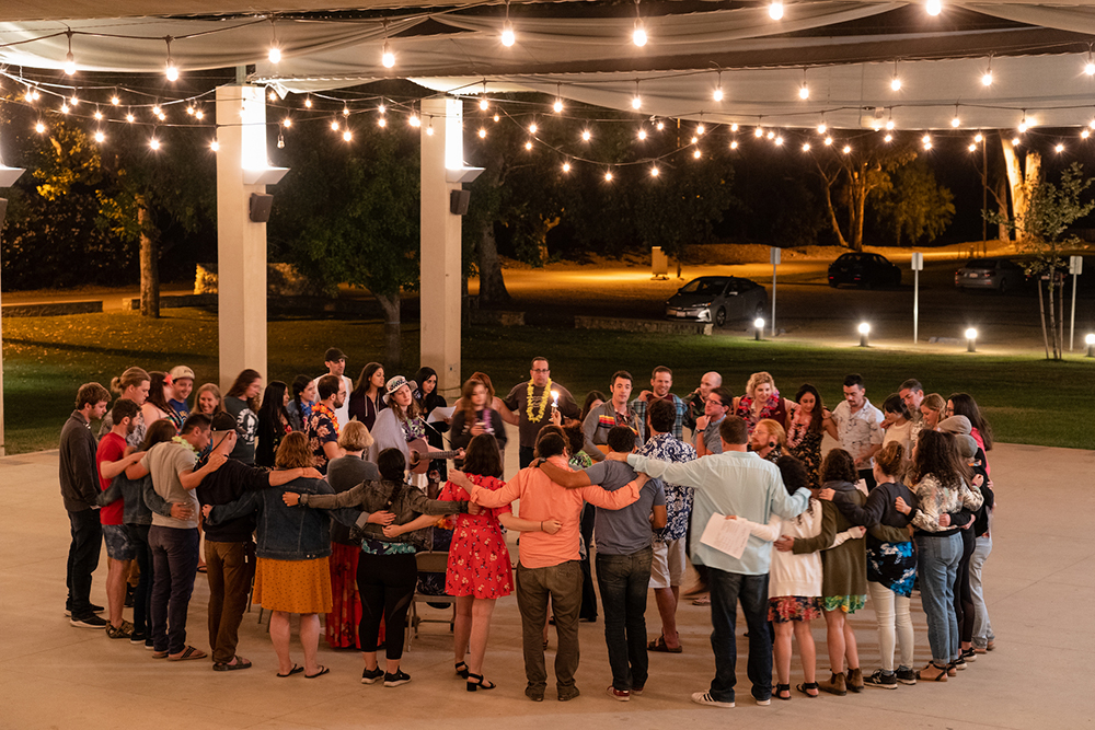 Adult campers participate in a Havdalah ceremony at Trybal SoCal 2019. Photo courtesy of Trybal Gatherings