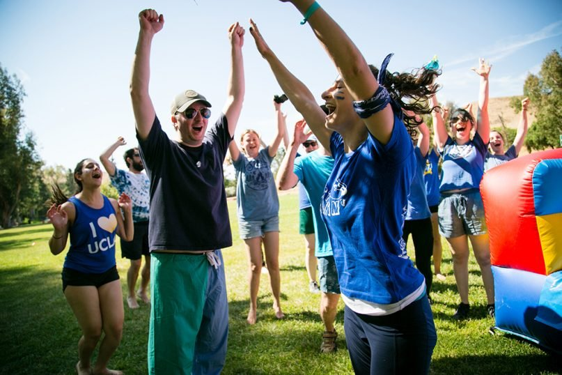 Adult campers cheer during events at Trybal SoCal 2019. Photo courtesy of Trybal Gatherings