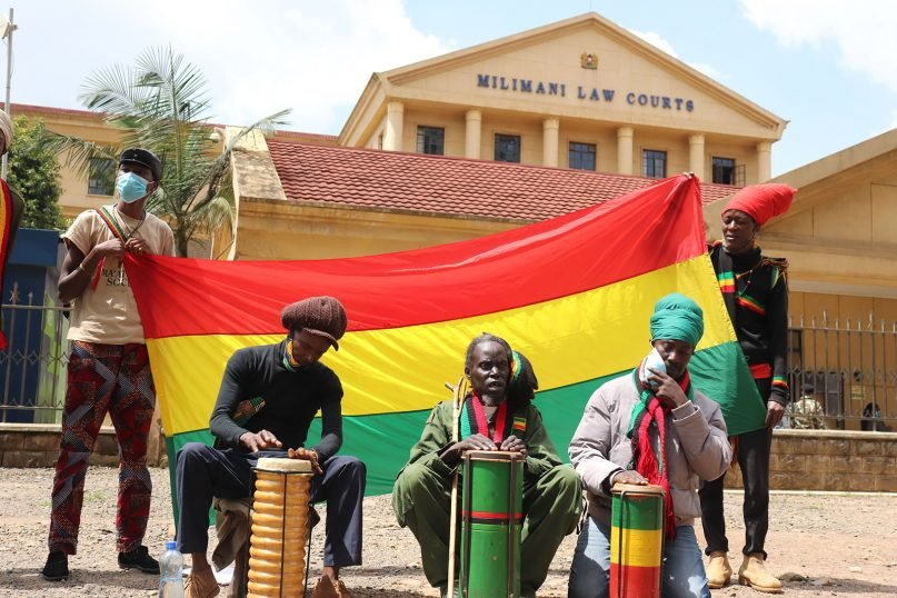Rastafarians play drums outside the high court in Nairobi, Kenya, during the filing of a petition calling for marijuana decriminalization, May 17, 2021. RNS photo by Fredrick Nzwili