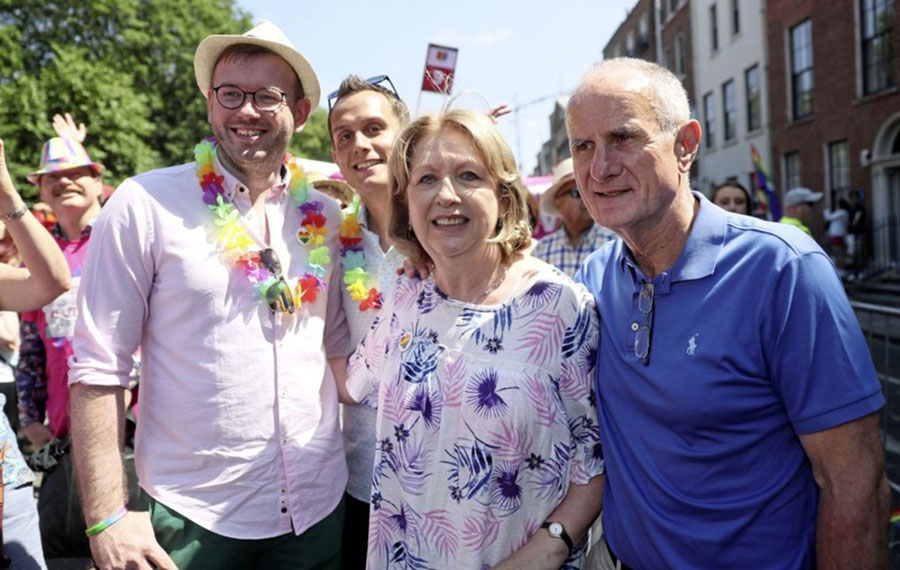 Former President of Ireland Mary McAleese, center, with her husband Martin, right, and her son Justin, second left, and his husband Fionan, left, during the Pride Parade in Dublin, Saturday, June 30, 2018. (Brian Lawless/PA Wire)