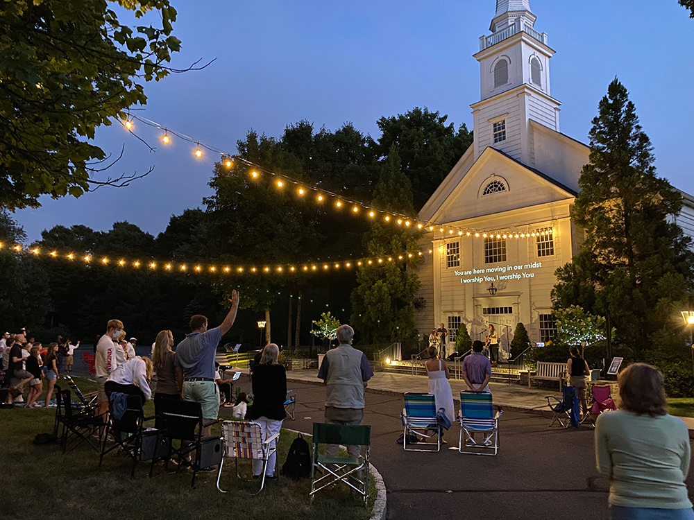 People attend an outdoor service at Stanwich Congregational Church in Greenwich, Connecticut, May 14, 2021. Photo by Nathan Hart