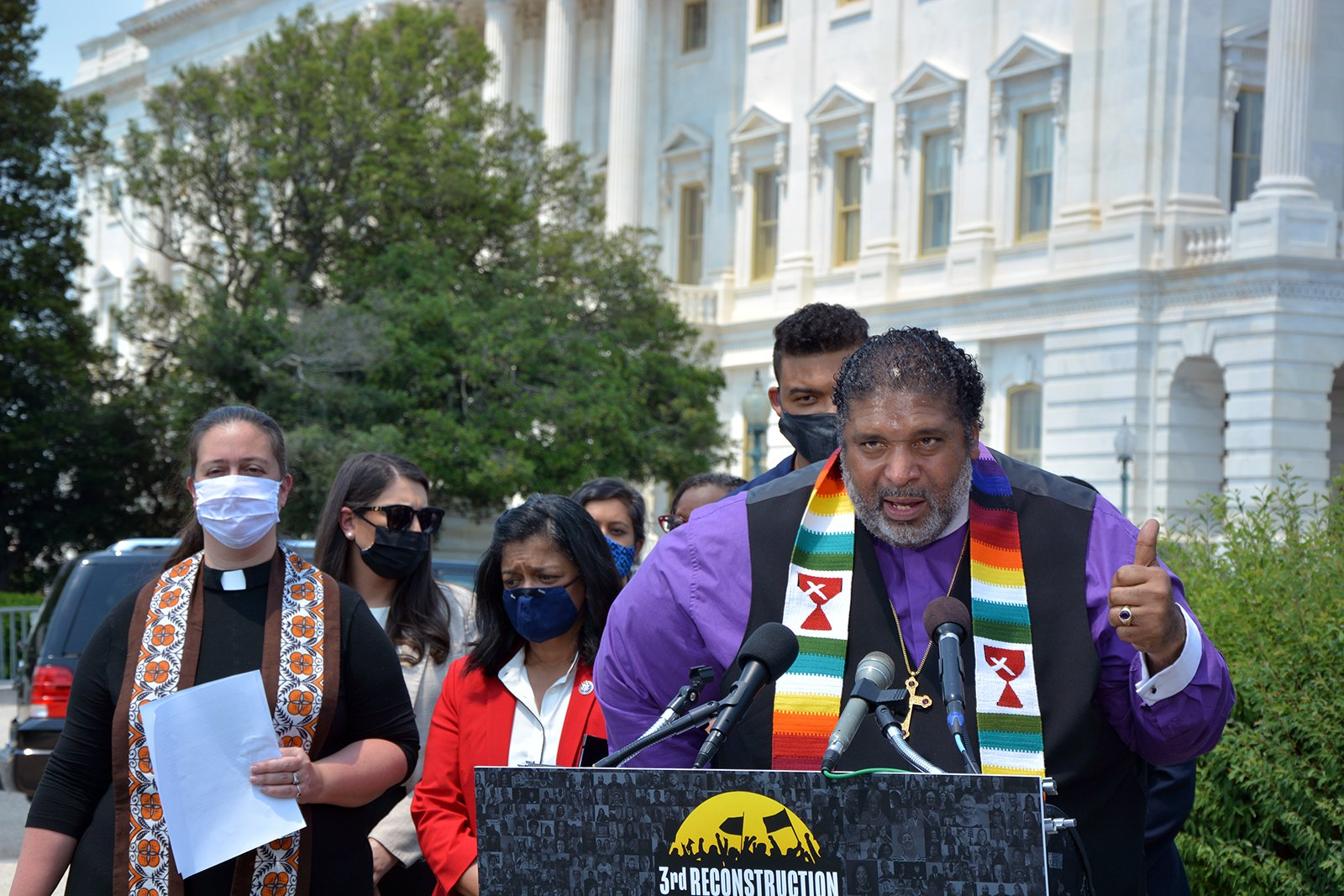 """Poor People's Campaign co-chair the Rev. William Barber speaks during the announcement of a new resolution titled """"Third Reconstruction: Fully Addressing Poverty and Low Wages from the Bottom Up,"""" Thursday, May 20, 2021, on Capitol Hill in Washington. RNS photo by Jack Jenkins"""