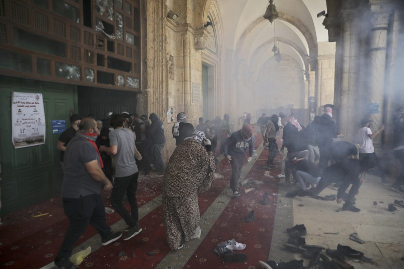 Palestinians clash with Israeli security forces on May 10, 2021, at the Al-Aqsa Mosque compound in Jerusalem's Old City.  (AP Photo/Mahmoud Illean)