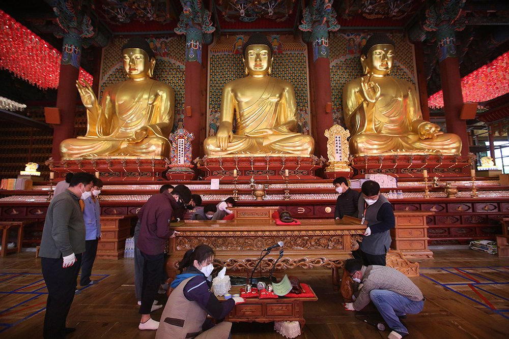 Buddhists arrange desks during a cleanup ahead of Buddha's Birthday, which falls on May 19, at Jogye Temple in Seoul, South Korea. (AP Photo/Ahn Young-joon)