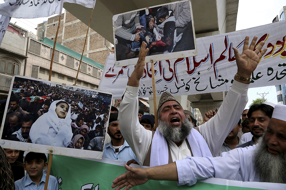 A demonstrator chants slogans during the annual Al-Quds, or Jerusalem, Day rally, in Peshawar, Pakistan, Friday, May 7, 2021. Jerusalem Day began after the 1979 Islamic Revolution in Iran, when the Ayatollah Khomeini declared the last Friday of the Muslim holy month of Ramadan a day to demonstrate the importance of Jerusalem to Muslims. (AP Photo/Muhammad Sajjad)