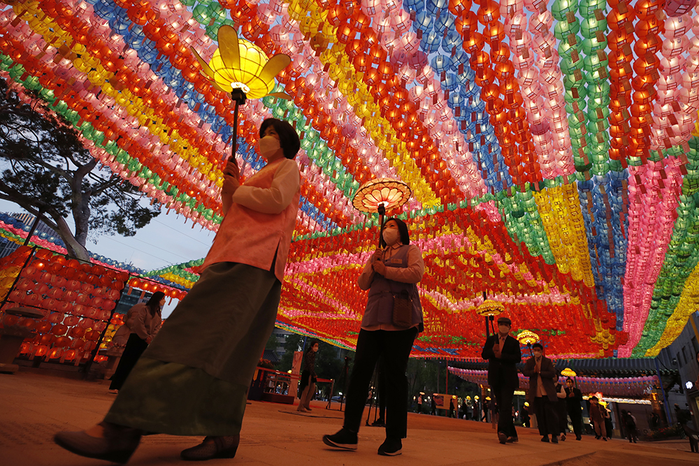 Buddhists carry lanterns to celebrate for the upcoming birthday of Buddha on May 19, at the Jogye temple in Seoul, South Korea, Thursday, May 6, 2021. (AP Photo/Lee Jin-man)