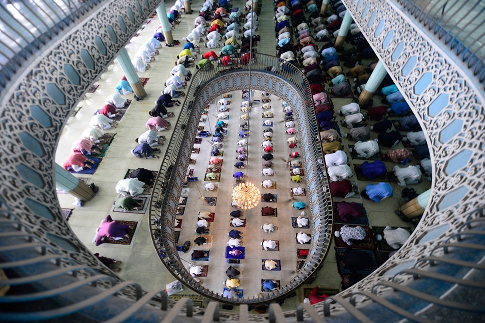 Bangladeshi Muslims offer Eid al-Fitr prayers inside the Baitul Mukarram Mosque in Dhaka, Bangladesh, Friday, May 14, 2021. Eid al-Fitr, festival of breaking of the fast, marks the end of the holy month of Ramadan. (AP Photo/Mahmud Hossain Opu)