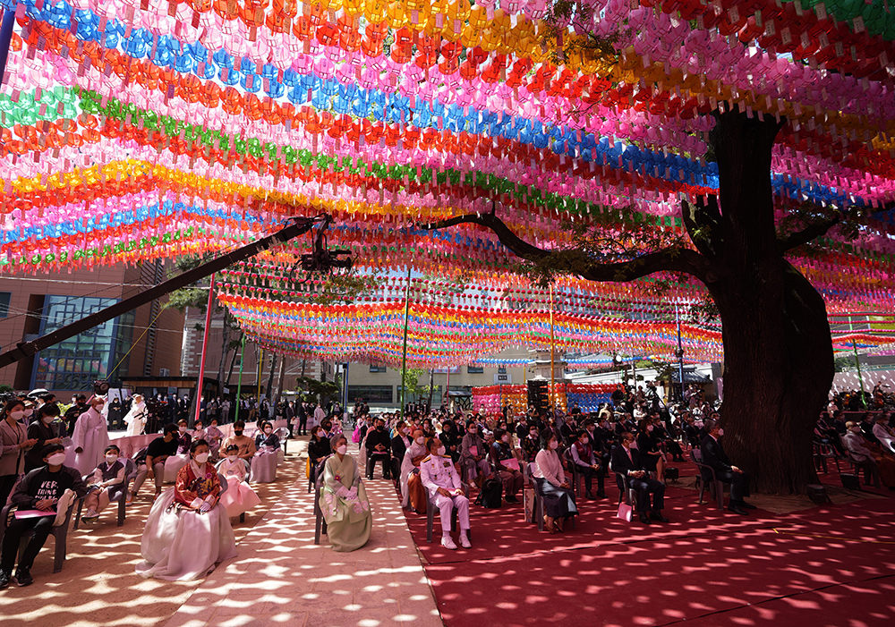 Buddhists attend at a ceremony to celebrate Buddha's birthday, while maintaining social distancing as a part of precaution against the coronavirus, at the Jogye temple in Seoul, South Korea, Wednesday, May 19, 2021. Buddhists visit temples across the country to celebrate the Buddha's birthday. (AP Photo/Lee Jin-man)