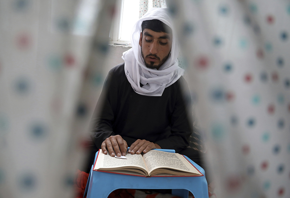 A Muslim man reads the Quran in a mosque during Itikaf, which requires staying in seclusion in a mosque to read the Quran and pray during the last ten days of the Islamic fasting month of Ramadan, in Kabul, Afghanistan, Tuesday, May 4, 2021. (AP Photo/Rahmat Gul)