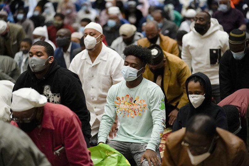 Worshippers perform Eid al-Fitr prayers at the Masjidullah Mosque in Philadelphia, May 13, 2021. (AP Photo/Matt Rourke)
