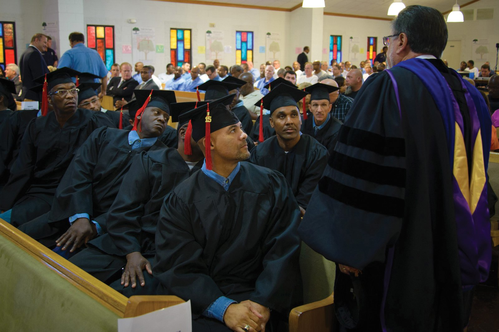 Male inmates participate in a graduation ceremony with New Orleans Theological Seminary's Leavell College at Louisiana State Penitentiary in Angola, Louisiana, in 2015. Photo courtesy of New Orleans Theological Seminary
