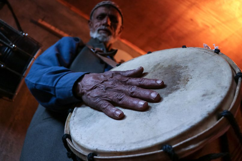 Manzoor Ahmed Lassi poses with his favorite drum at his residence in Srinagar, Kashmir, India. Lassi, 57, has worked as a Ramadan night drummer in different areas of Srinagar for the past 45 years. Photo by Adil Abass