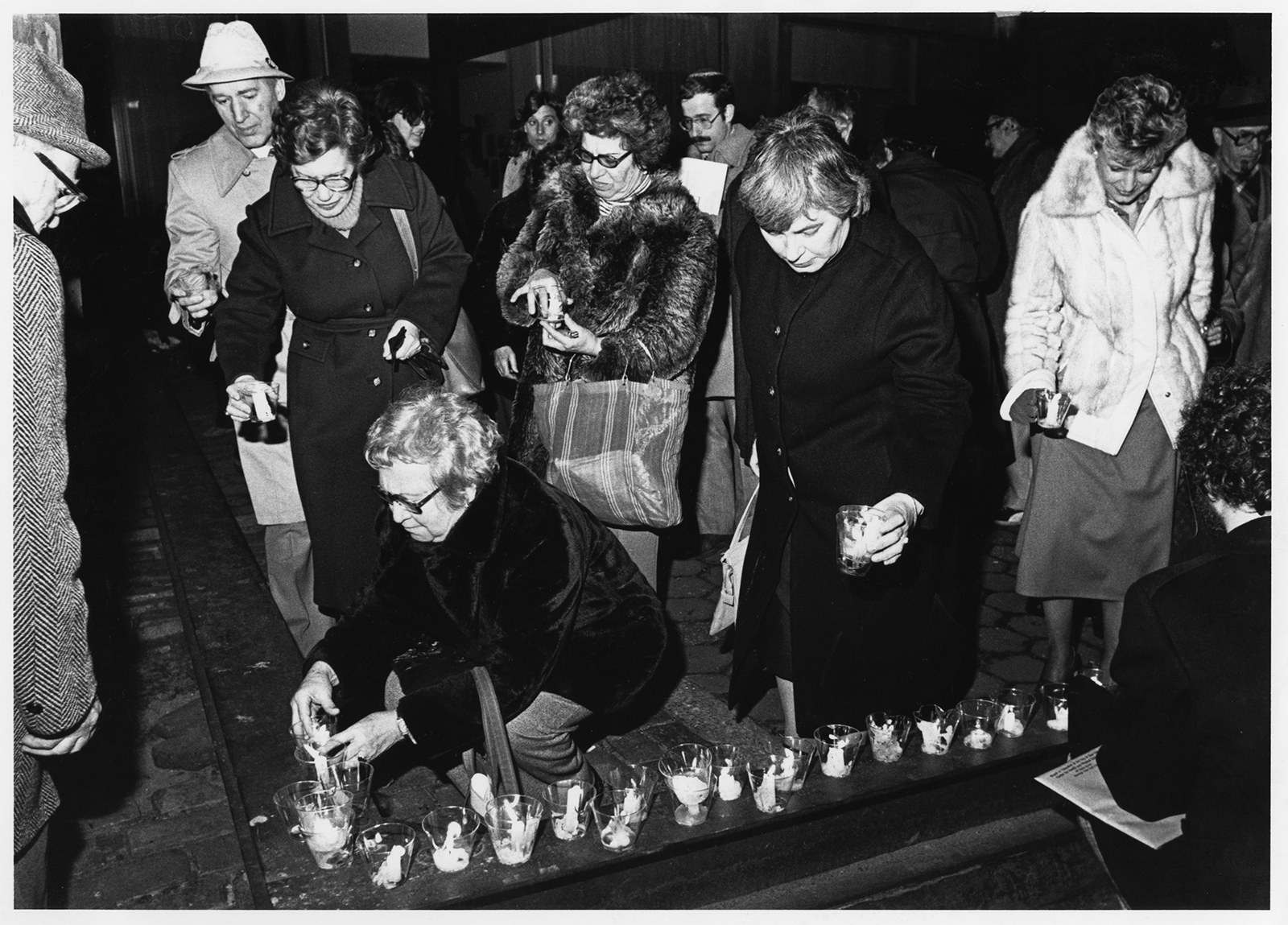 """Participants mark """"Raoul Wallenberg Day"""" by placing candles at the Isaiah Wall near the United Nations on Mar. 27, 1980, in New York. Mr. Wallenberg, a Swedish diplomat in war-time Budapest helped save nearly 100,000 Hungarian Jews from the Nazis during World War II. Wallenberg was taken prisoner by the Soviet Army in 1945, and reported dead in 1947. Many groups, including the Anti-Defamation League of B'nai B'rith and the U.S. Free Raoul Wallenberg Committee, believed reports that he languished in a Russian prison for years past 1947. RNS archive photo by Odette Lupis. Photo courtesy of the Presbyterian Historical Society."""