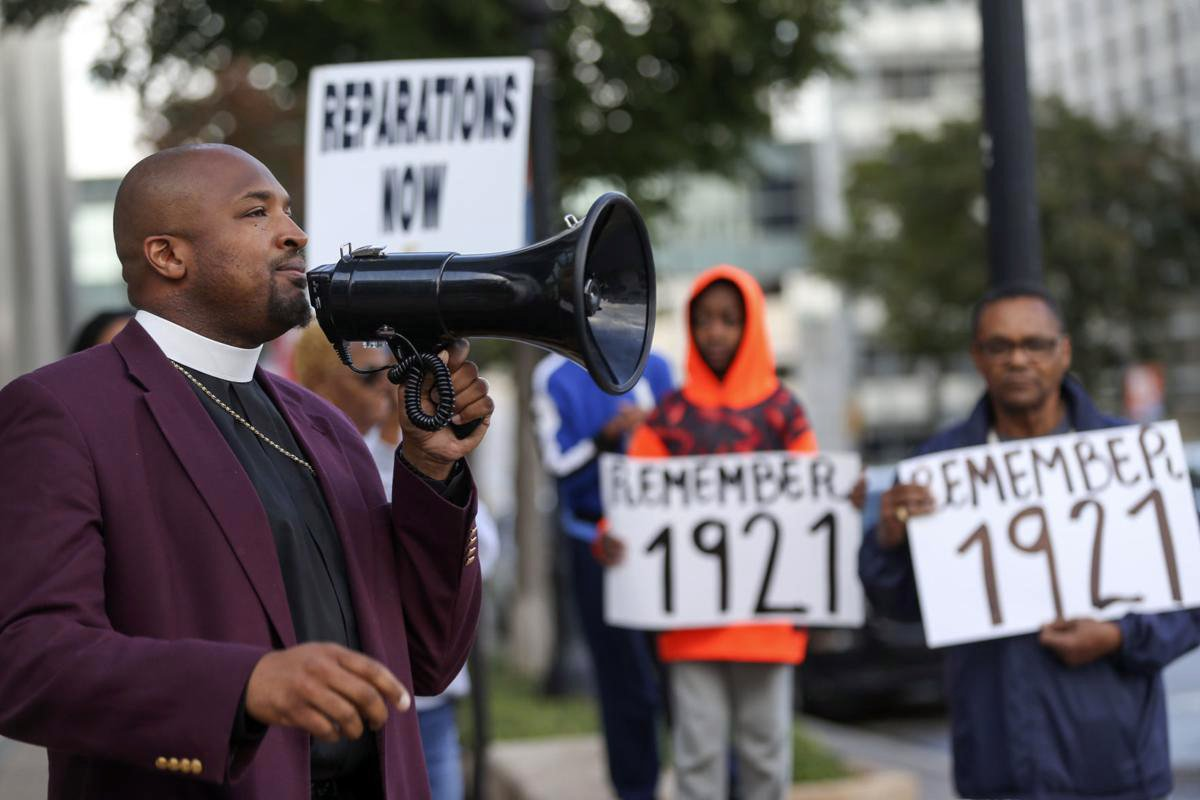 The Rev. Robert R.A. Turner, left, draws attention to the 1921 Tulsa massacre every week in Tulsa, Oklahoma. Courtesy photo