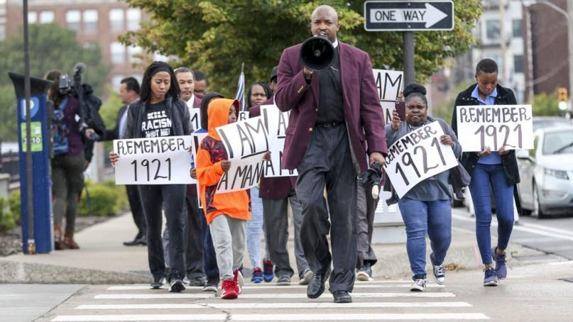 The Rev. Robert R.A. Turner, center, draws attention to the 1921 Tulsa Massacre every week in Tulsa, Oklahoma. Courtesy photo