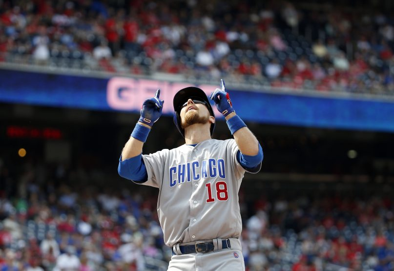 Chicago Cubs' Ben Zobrist celebrates as he crosses the plate after hitting a solo home run in the first inning of a baseball game against the Washington Nationals at Nationals Park, June 15, 2016, in Washington. (AP Photo/Alex Brandon)
